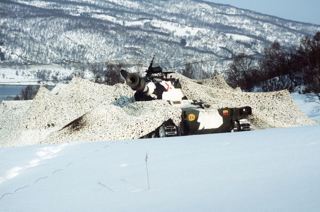 Camouflage netting covers Norwegian M109 155 mm self-propelled Howitzers during Operation COLD WINTER'87, a NATO-sponsored military exercise