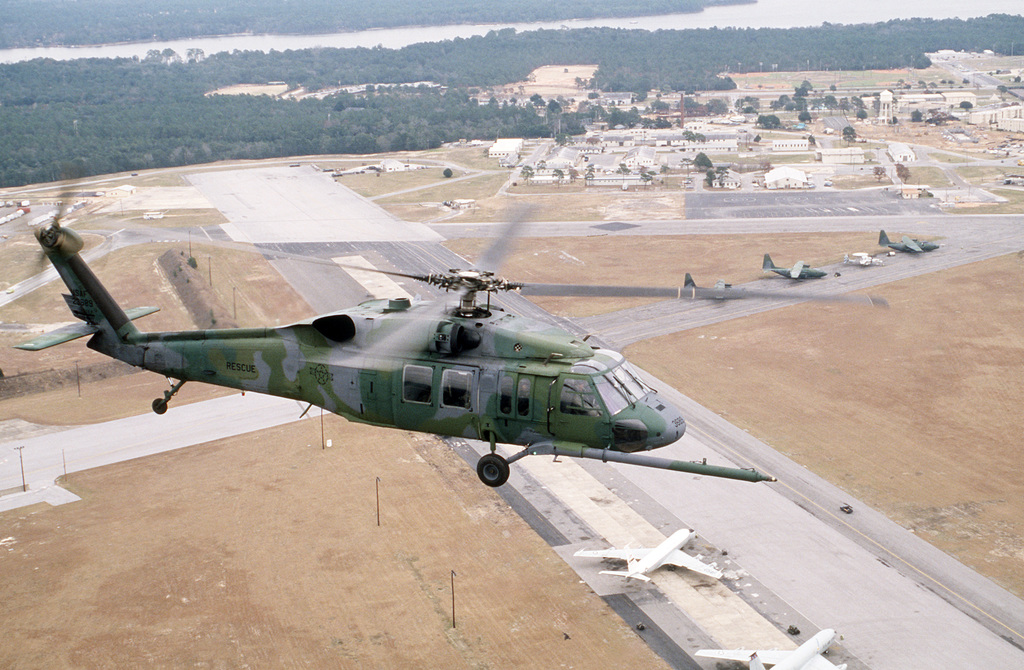 An air-to-air right overhead view of a modified UH-60A Black Hawk (Blackhawk) helicopter of the 55th Aerospace Rescue and Recovery Squadron. The helicopter was fitted with a refueling probe at the Sikorsky Aircraft plant in Troy, Alabama