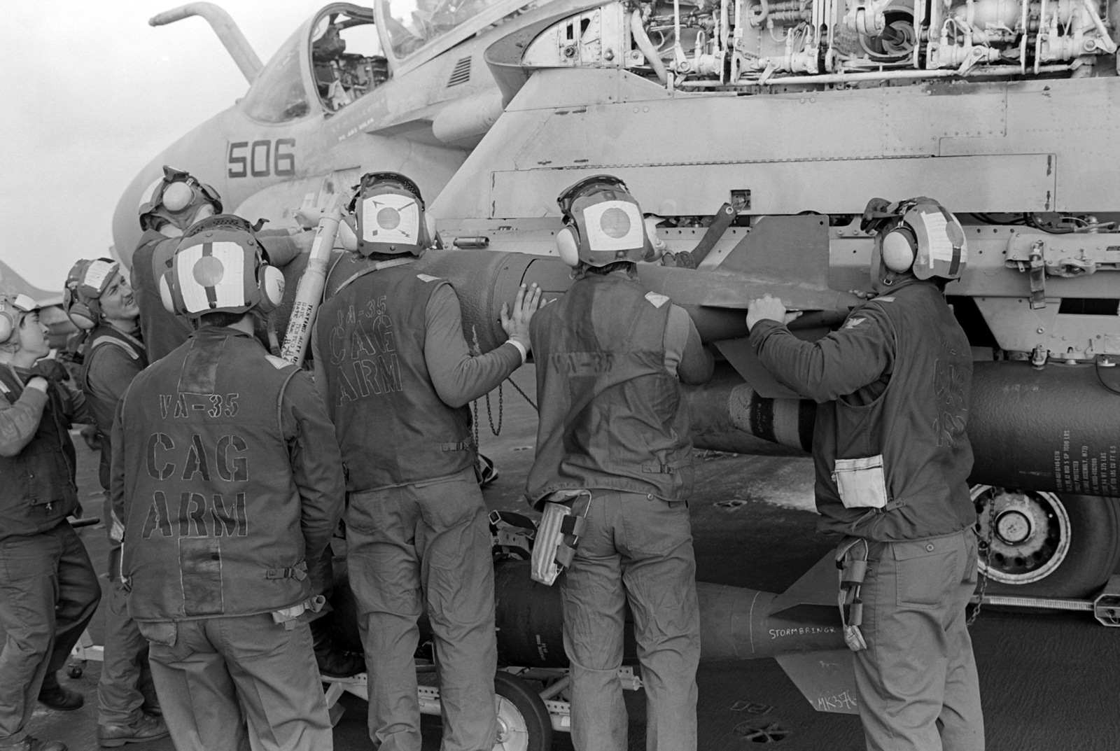 Attack Squadron 35 (VA-35) aviation ordnancemen load a Mark 83 1000-pound bomb onto an A-6E Intruder aircraft aboard the nuclear-powered aircraft carrier USS NIMITZ (CVN 68) during flight operations off the coast of Beirut, Lebanon