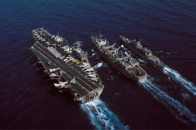 An aerial port quarter view of the nuclear-powered aircraft carrier USS NIMITZ (CVN 68) participating in an underway replenishment with the replenishment oiler USS KALAMAZOO (AOR 6) and the guided missile cruiser USS JOSEPHUS DANIELS (CG 27). The ships are underway off the coast of Beirut, Lebanon