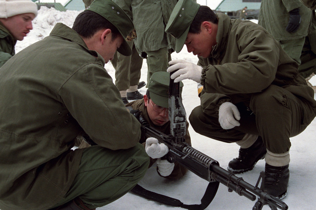 Members of the Japanese Ground Self-Defense Force inspect a US Army M60 general-purpose machine gun during Exercise NORTHWIND '87. Members of the 25th Infantry Division are undergoing 23 days of special cold weather training with members of the Japanese Ground Self-Defense Force in the Kotani and Hirosaki Training Area