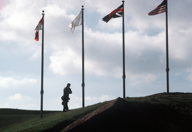 A person dressed in a Confederate Civil War uniform stands on the ramparts of Fort Morgan while participating in a re-enactment of the Battle of Mobile Bay.  The re-enactment is one of a series of events celebrating the commissioning of the guided missile cruiser USS MOBILE BAY (CG 53)