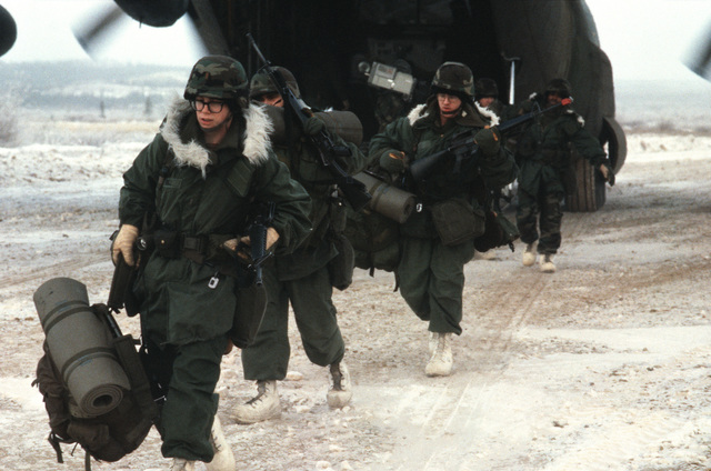 Members of Company C, 6th Battalion, 327th Infantry, 6th Infantry Division (Light) disembark from a C-130 Hercules aircraft during a combined arms live fire exercise (CALFEX)