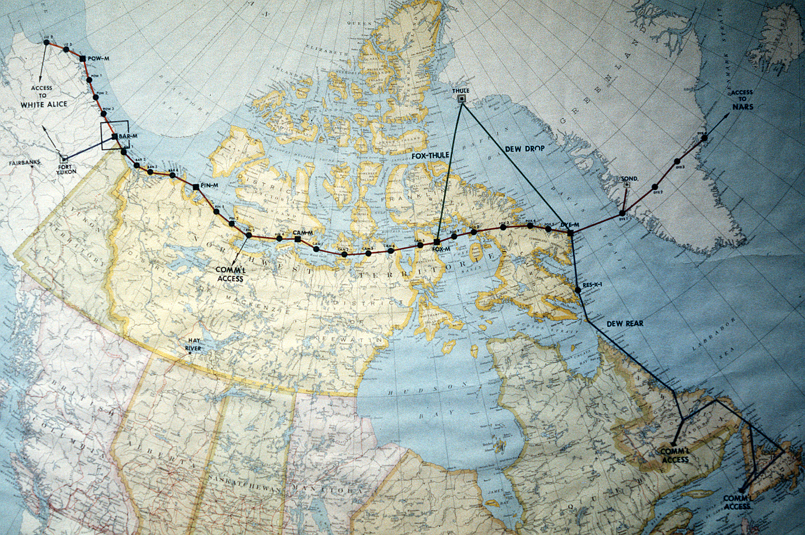 A map of North America near the Arctic Circle showing 30 radar sites spread out along the Distant Early Warning (DEW) Line. Running from Alaska, across Northern Canada to Greenland, the line is approximately 3,600 miles long
