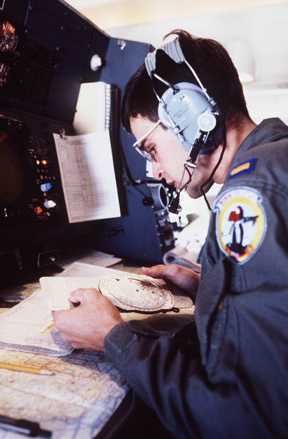 Second Lieutenant (2LT) Anthony Hingle, a navigation student, plots a course onboard a T-43A aircraft during a training flight