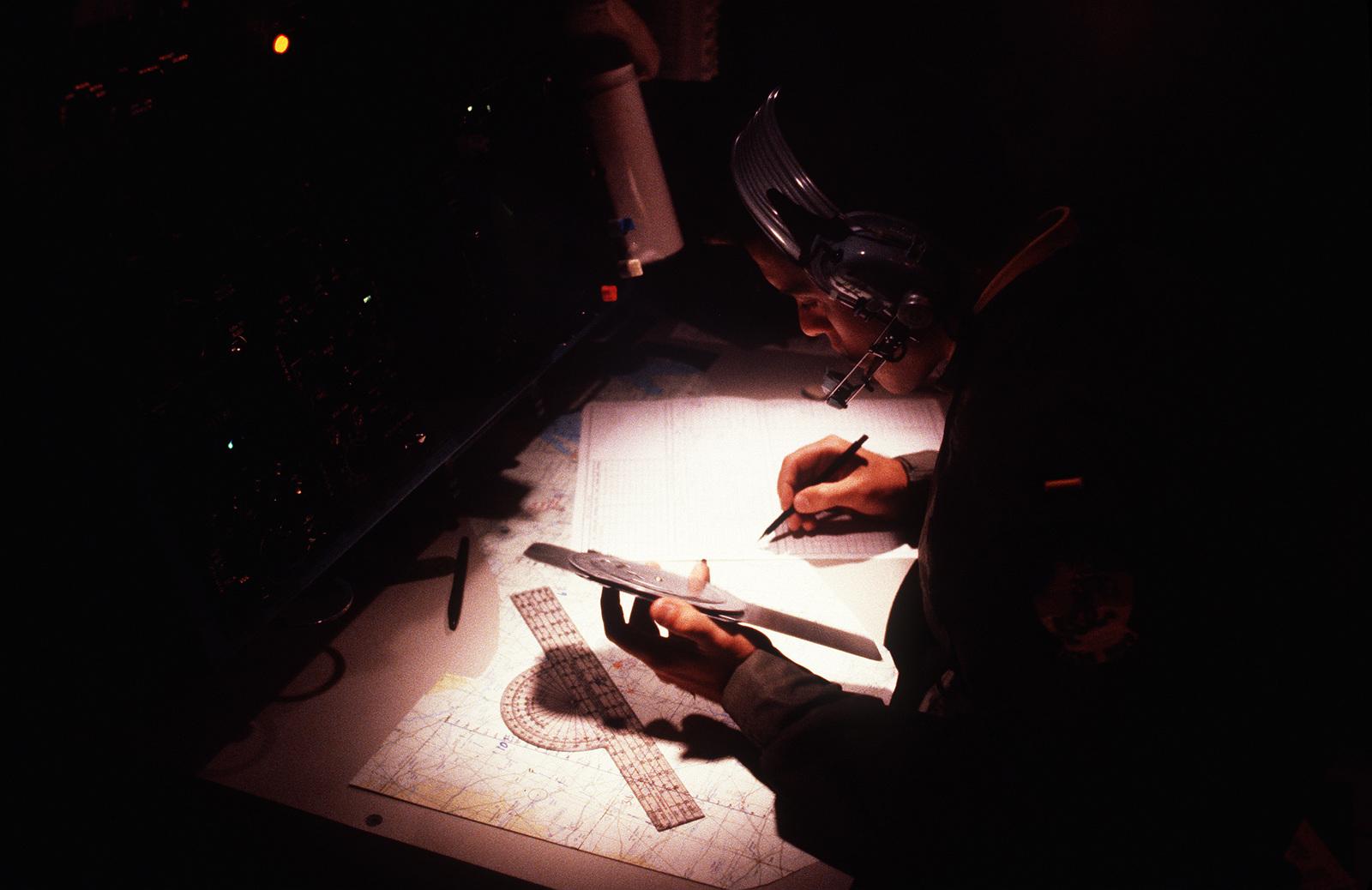 Second Lieutenant (2LT) Steven Ferra, a navigation student, plots a course in a flight simulator