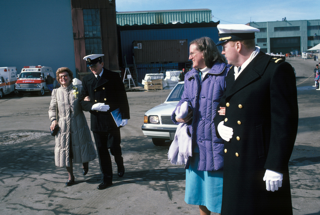 Sponsor Elizabeth Kauffman Bush, left, daughter of Vice Admiral (VADM) James L. Kauffman and sister of Rear Admiral Draper L. Kauffman, and M. Carey Kauffman, matron of honor and daughter of Rear Admiral Draper L. Kauffman, arrive for the commissioning of the guided missile frigate USS KAUFFMAN (FFG 59). Both VADM Kauffman are being honored as the ship's namesakes