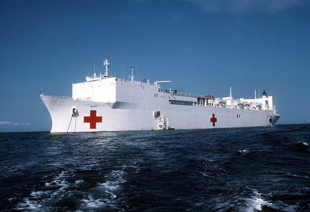 A port bow view of the hospital ship USNS MERCY (T-AH-19) anchored off the coast. The recently outfitted Military Sealift Command ship is visiting various ports in the Philippines during the first phase of its five-month humanitarian medical service and training mission. While in the Philippines, U.S. Navy, Army and Air Force medical personnel embarked aboard the MERCY are providing treatment for indigent Filipinos, both ashore and aboard ship
