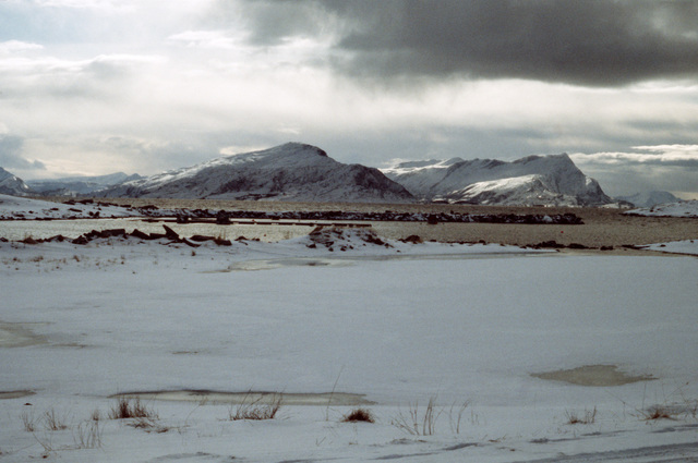 A scenic view of a mountain range taken during Exercise COLD WINTER'87