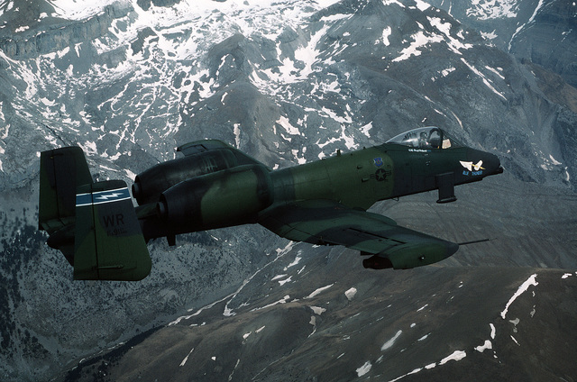 An air-to-air right side view of a 91st Tactical Fighter Squadron A-10A Thunderbolt II aircraft flying against the backdrop of the French Pyrennes Mountains while taking part in a training mission along the French and Spanish border during the squadron's