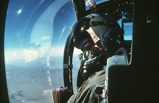 CAPT. Eric Stoll, pilot of an OV-10 Bronco aircraft of the 27th Tactical Air Support Squadron, looks out the cockpit of his aircraft while in-flight over George Air Force Base