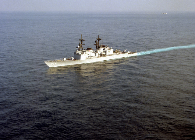 An aerial port bow view of the guided missile destroyer USS CALLAGHAN (DDG-994) underway