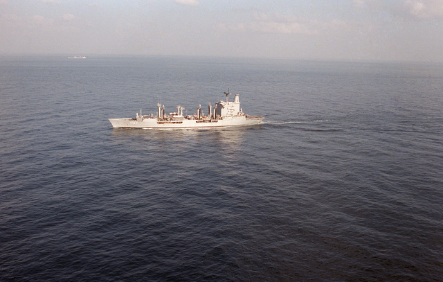 An aerial port view of the fleet oiler USS WILLAMETTE (AO 180) underway