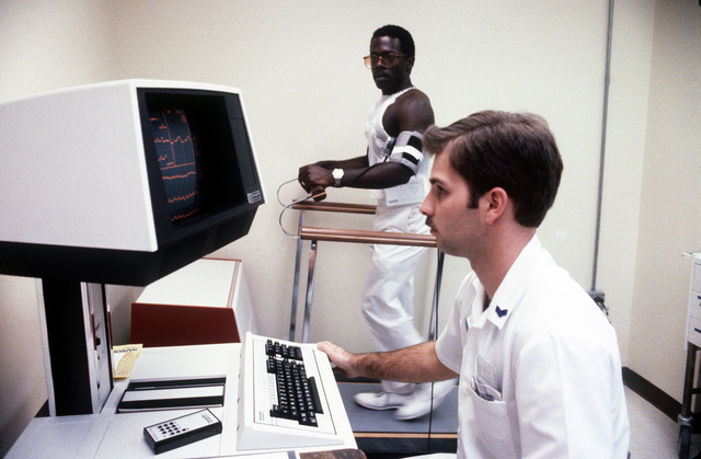 SGT. John Henshew uses a computer to monitor the heart rate of a patient on the treadmill at the U.S. Air Force Regional Hospital