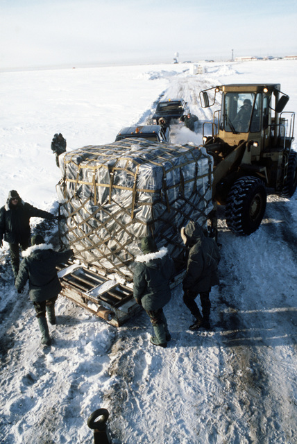 A Case M6K rough terrain forklift truck transports a pallet of supplies needed to make the tactical air navigation (TACAN) system operational during Exercise COBBLER FREEZE'87, a cold-weather force projection exercise conducted by the Alaskan Air Command