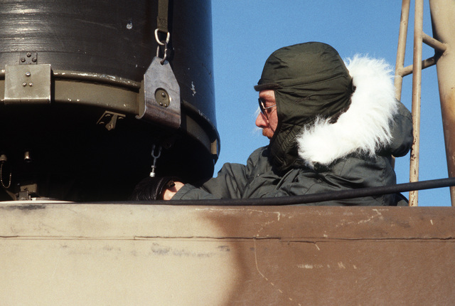 STAFF Sergeant (SSGT) Andy Neitzel of the 5th Combat Information Systems Group secures a radar dome to a plate mounted on top of a tactical air navigation (TACAN) system van.  He is participating in Exercise COBBLER FREEZE'87, a cold-weather force projection exercise conducted by the Alaskan Air Command
