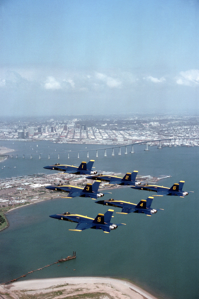 Six F/A-18A Hornet aircraft of the US Navy's Blue Angels flight demonstration squadron fly in a delta formation near the San Diego-Coronado Bridge