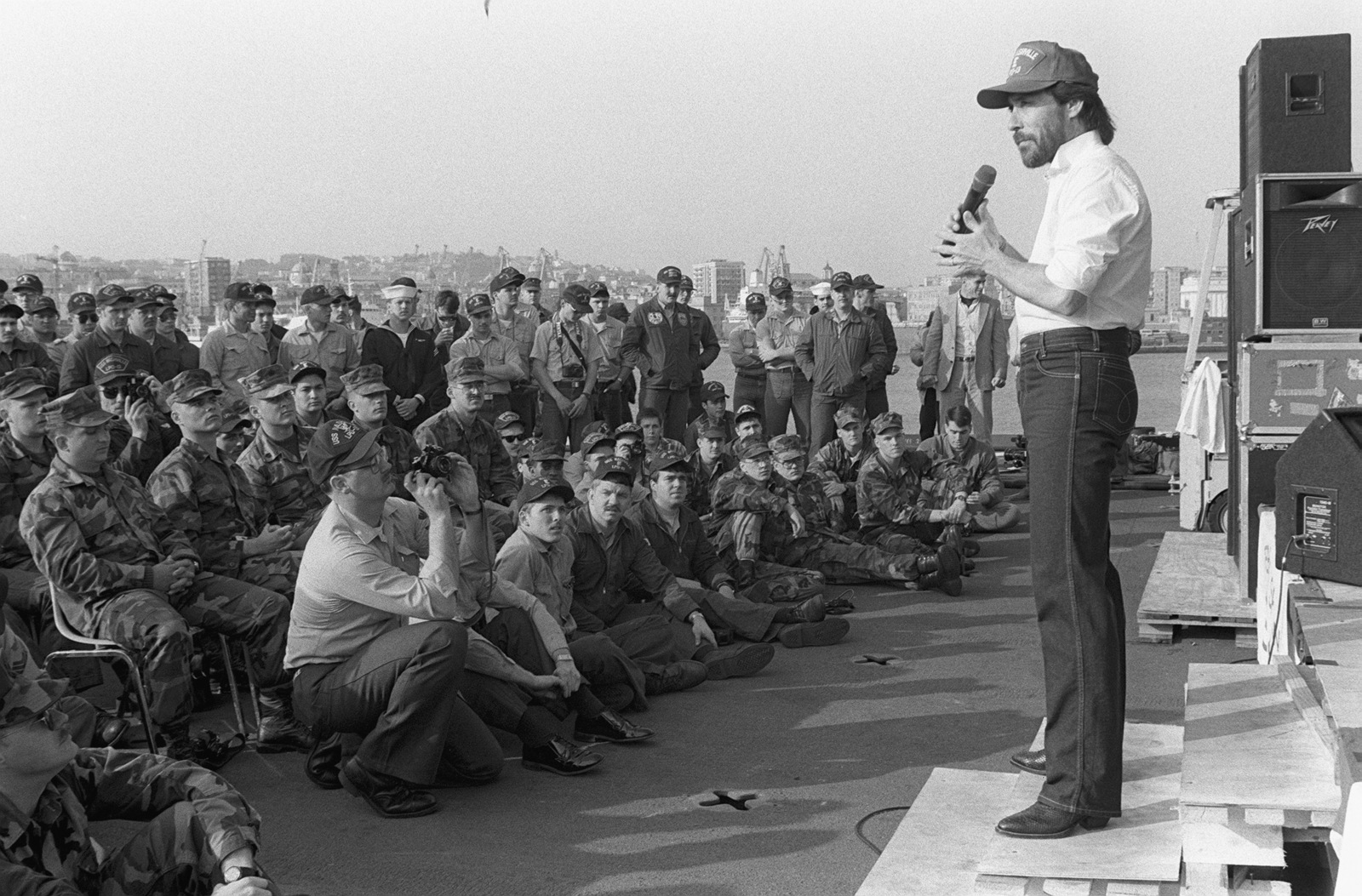 Country music star Lee Greenwood performs for crewmen and