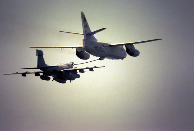 An air to air right rear view of a KA-3D Skywarrior tanker-configured aircraft refueling an EA-6B Prowler aircraft