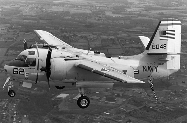 An air-to-air left side view of a C-1A Trader carrier on-board delivery (COD) aircraft from Naval Air Station, Willow Grove, Pennsylvania. The Trader will soon be retired from service due to the fire hazard created by storing its high-octane fuel aboard ship