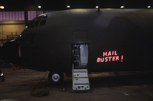 Reflective tape on the side of a C-130E Hercules aircraft commemorates the plane's victory over a hailstorm which it encountered while on a routine mission from its home base at Hurlburt Field, Florida (FL).  Although the aircraft sustained extensive dama