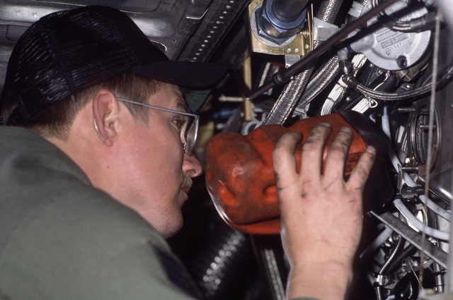 STAFF Sergeant (SSGT) Albert M. Mikolajczyk, 834th Aircraft Generation Squadron, inspects the engines of a C-130E Hercules aircraft before approving it for flight.  The plane sustained damage when it encountered a hailstorm while on a routine mission from