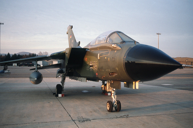 A right front view of a West German Tornado aircraft parked on the flight line during the change of command ceremony for the US Air Force Europe, and Allied Air Forces Central Europe
