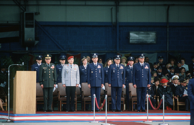General officers stand at the speakers podium during the change of command ceremony for General (GEN) Charles L. Donnelly Jr., departing commander in chief, US Air Force Europe (USAFE), and Allied Air Forces Central Europe.  They are, left to right:  GEN Bernard W. Rogers, supreme allied commander for NATO; GEN Chalupa, commander in chief, Allied Air Forces Central Europe; GEN Larry D. Welch, Air Force chief of staff; Donnelly and GEN William L. Kirk, former commander, 9th Air Force Kirk is assuming command of the USAFE