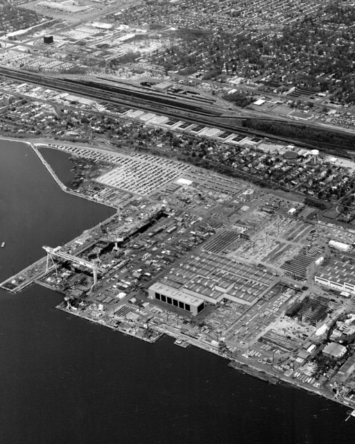 An aerial view of the nuclear-powered aircraft carrier USS ABRAHAM LINCOLN (CVN 72) under construction at the Newport News Shipbuilding and Dry Dock Co. shipyard
