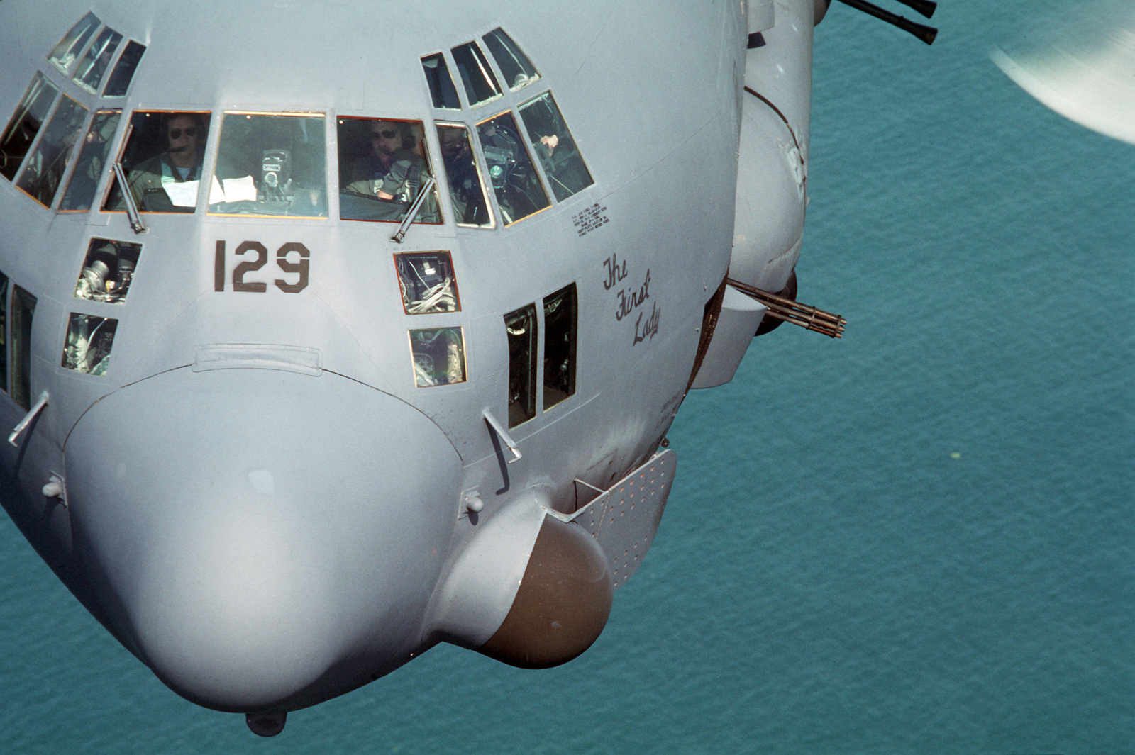"""An air-to-air close-up view of a 919th Special Operations Group AC-130 Hercules gunship flying over the northeast coast of Honduras during Exercise PEGASUS'87.  The aircraft, nicknamed""""The First Lady,""""is flying day and night combat air support for Honduran and US Army Special Forces"""