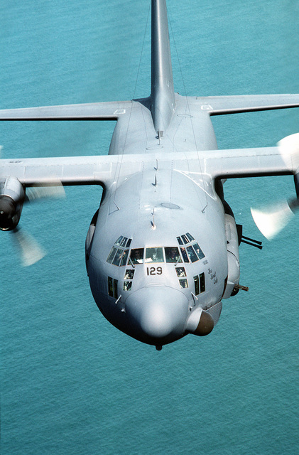 "An air-to-air front view of a 919th Special Operations Group AC-130 Hercules gunship flying over the northeast coast of Honduras during Exercise Pegasus '87. The aircraft, nicknamed ""The First Lady,"" is flying day and night combat air support for Honduran and U.S. Army Special Forces"