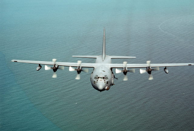 "An air-to-air front view of a 919th Special Operations Group AC-130 Hercules gunship flying over the northeast coast of Honduras during Exercise PEGASUS'87.  The aircraft, nicknamed""The First Lady,""is flying day and night combat air support for Honduran and US Army Special Forces"