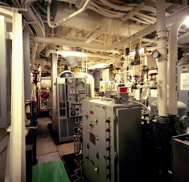 The auxiliary machinery room No. 3 aboard the guided missile frigate USS RODNEY M. DAVIS (FFG 60).  The ship is 100 percent complete