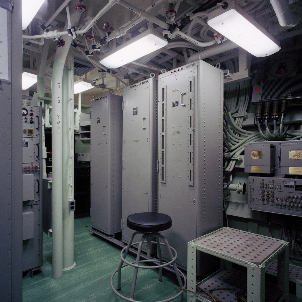 The sonar equipment room aboard the guided missile frigate USS RODNEY M. DAVIS (FFG 60) tied up at a pier at Todd Shipyards.  The ship is 100 percent complete