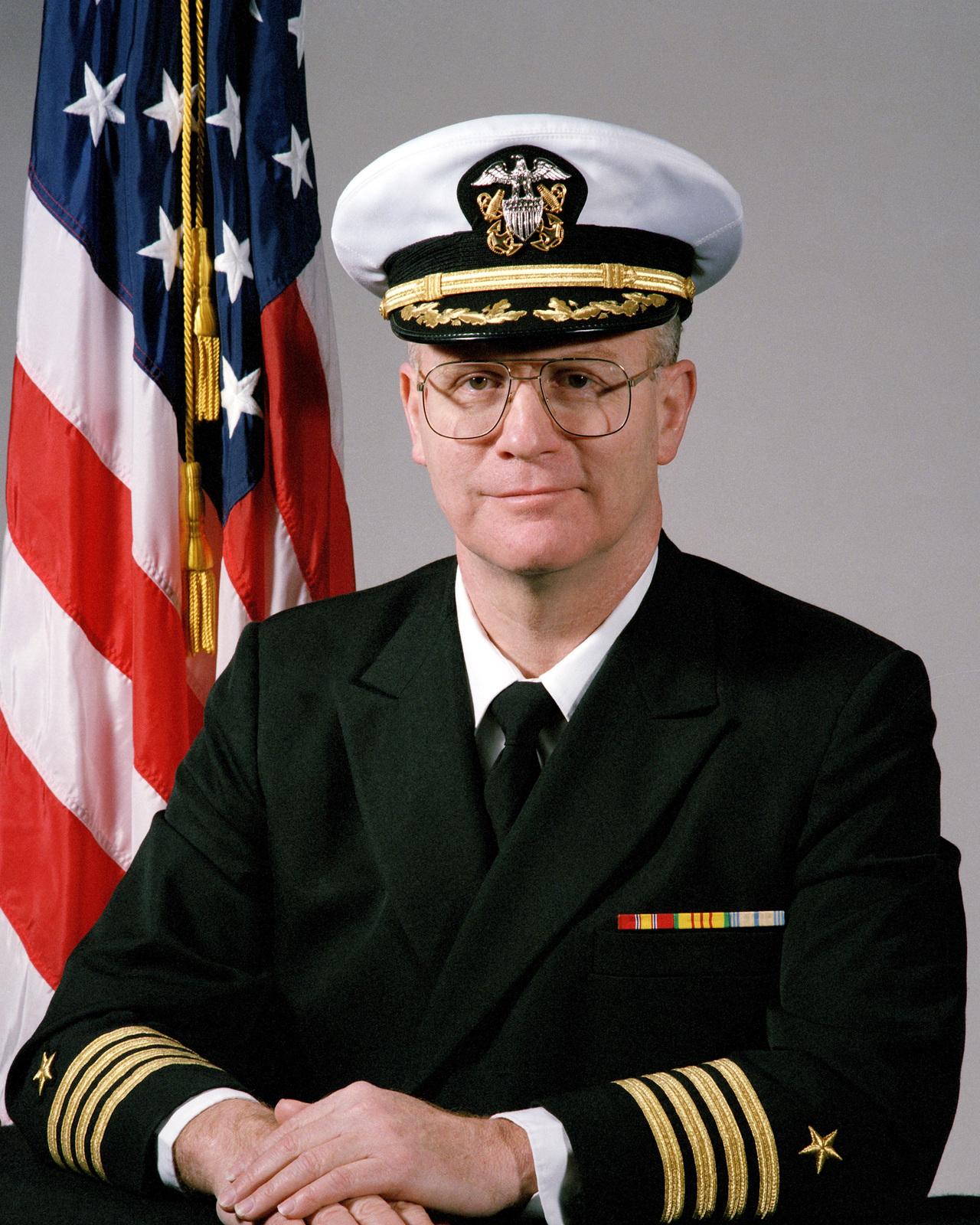 Portrait:  US Navy (USN) Captain (CAPT) David J. Adams,  (covered)