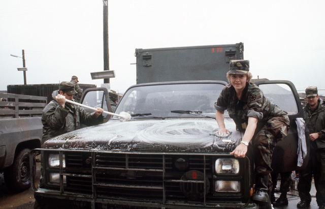Private First Class (PFC) Michele Caprara, Company A, 711th Signal Battalion, Alabama National Guard, soaps down a truck on a wash rack during the joint US/South Korean Exercise TEAM SPIRIT'87