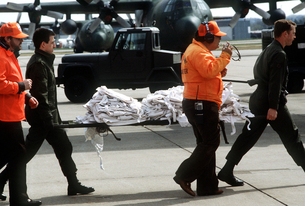 Airmen carry medical supplies to the treatment area during the National Disaster Medical System exercise