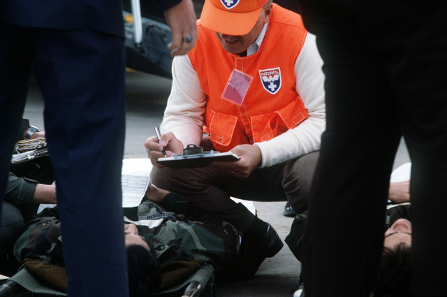 Simulated casualties are treated on the flight line during the National Disaster Medical System exercise