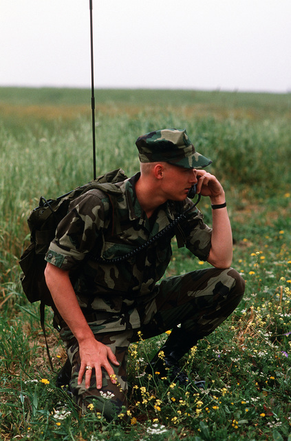 A member of the 7th Special Operations Squadron uses a radio telephone to coordinate movements in the field during Exercise Flintlock '87, a joint Special Operations Command Europe exercise testing the effectiveness of the combined Air Force, Army and Nav