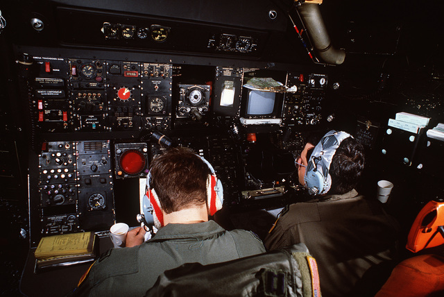 An interior view of the cockpit of an MC-130E Hercules aircraft assigned to the 7th Special Operations Squadron. The aircraft is in flight to Moron Air Base, Spain, from Rhein-Main Air Base, West Germany during Exercise FLINTLOCK '87, a joint Special Oper