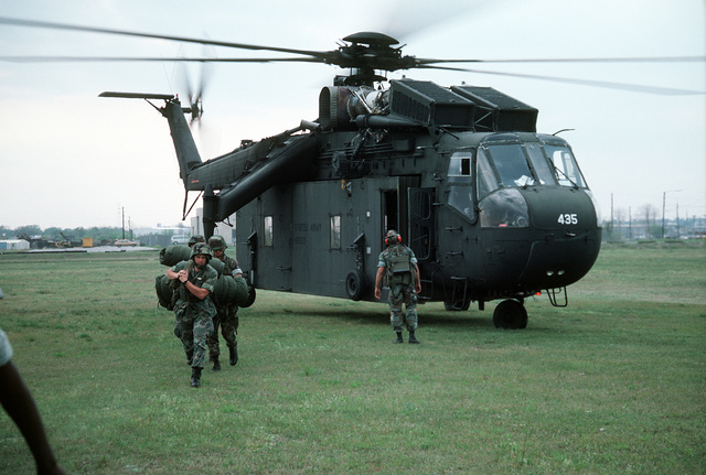 Marine reservists file off a CH-54 Tahre helicopter after participating in maneuvers at Morris Island