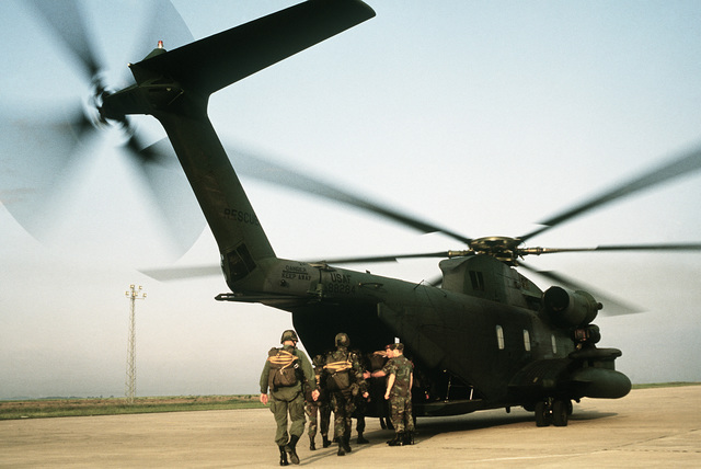 Members of the Spanish and American Air Force load into the rear of an HH-53C Jolly Green Giant helicopter assigned to the 67th Aerospace Rescue and Recovery Service.  They are participating in Exercise FLINTLOCK'87, a joint Special Operations Command Eur