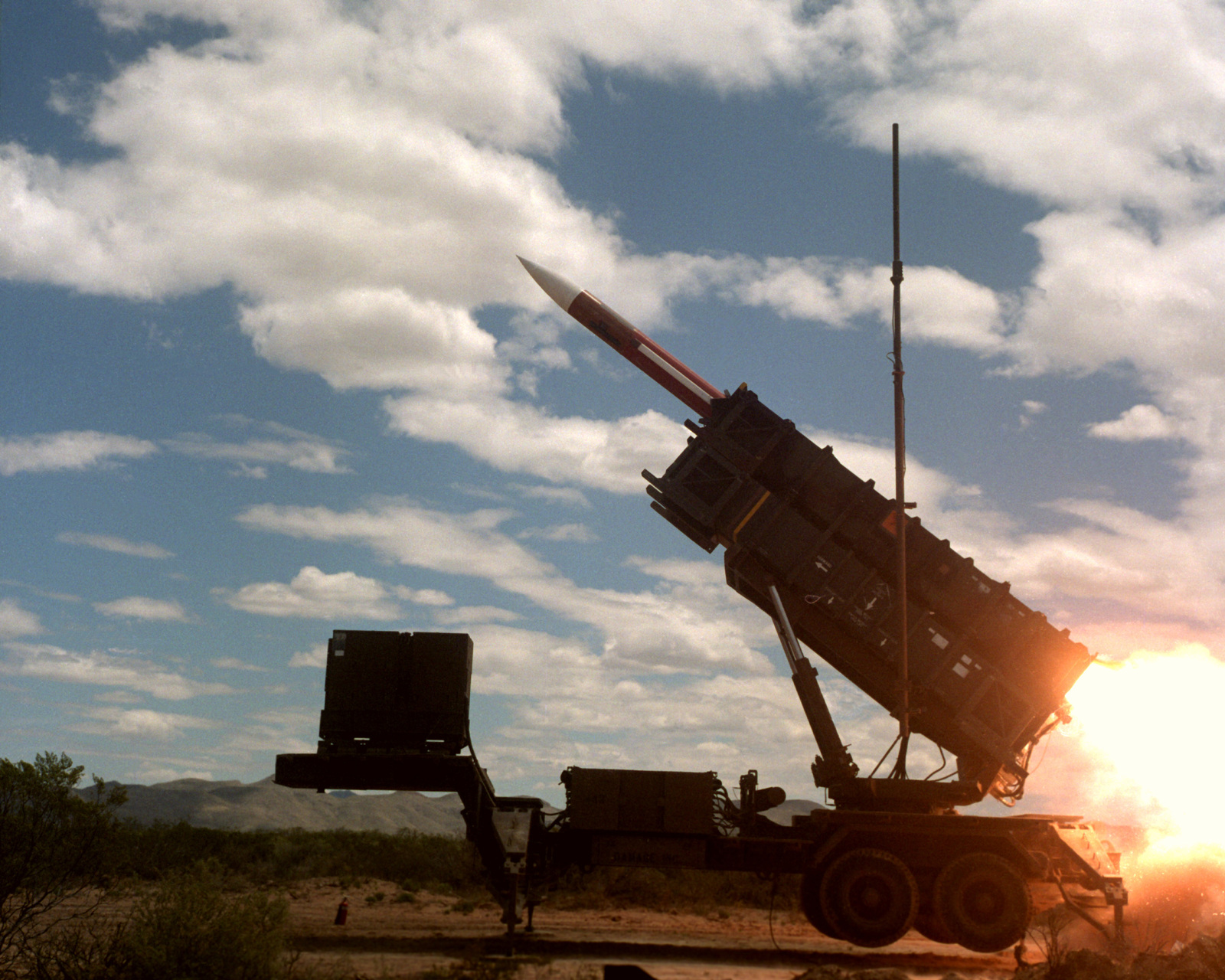 An MIM-104 Patriot missile is fired by members of Btry, B, 8th Bn., 43rd Air Defense Artillery. (Third view in a series of five) - U.S. National Archives & DVIDS Public Domain