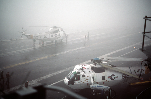 Heavy fog shrouds the flight deck as a Helicopter Anti-submarine Squadron 5 (HS-5) SH-3H Sea King helicopter to an elevator aboard the nuclear-powered aircraft carrier USS DWIGHT D. EISENHOWER (CVN 69).  The fog forced the cancellation of flight operations.  Note:  Sixth view in a series of six