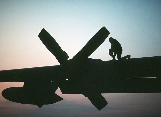 A member of the 440th Tactical Airlift Wing checks a propeller of an Air Force Reserve C-130A Hercules aircraft prior to an early morning departure to Aviano Air Base, Italy during Exercise Volant Partner 87-1 deployment activities. Reservists from the wing are flying airlift missions to 30 air bases in nine NATO nations