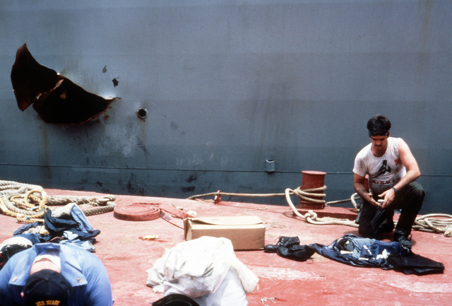 A sailor takes a break during repair operations to the guided missile frigate USS STARK (FFG-31). The STARK was hit by two Iraqi-launched Exocet missiles while on patrol in the Persian Gulf