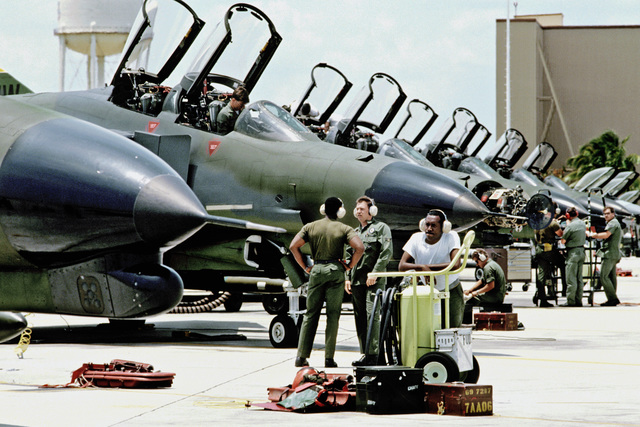 Ground crewmen service 37th Tactical Fighter Wing F-4G Wild Weasel Phantom II aircraft on the flight line during Exercise SOLID SHIELD'87