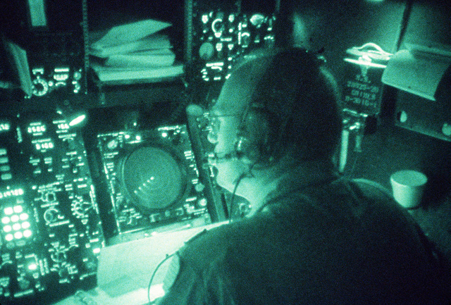 MAJ. Robert Lewis mans the navigation console aboard an MC-130 Hercules aircraft during Exercise Solid Shield '87