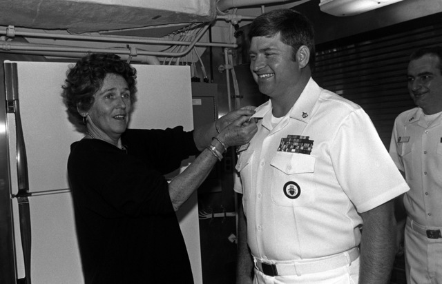Maryland Representative Beverly Byron pins new anchors on SENIOR CHIEF Personnelman (PNCS) Scott Plew, aboard the Aegis Guided Missile Cruiser USS ANTIETAM (CG 54).  Byron, the ship's sponsor, is visiting during final readiness work prior to commissioning