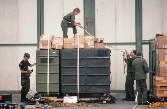 Members of the 34th Mobile Aerial Port Squadron, Air Force Reserve prepare pallets for shipment back to the United States by 440th Tactical Airlift Wing C-130A Hercules aircraft during the redeployment phase of Exercise VOLANT PARTNER 87-1.  While in Europe, members of the wing flew airlift missions to 30 air bases in nine NATO nations